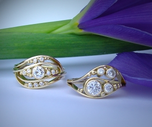 Two 18ct gold dress wave rings with Diamonds.
